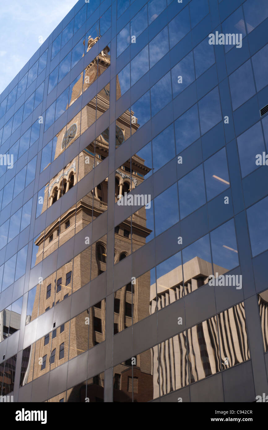 Landmark Daniels & Fisher Tower reflected in glass of modern building in downtown Denver, Colorado - Stock Image