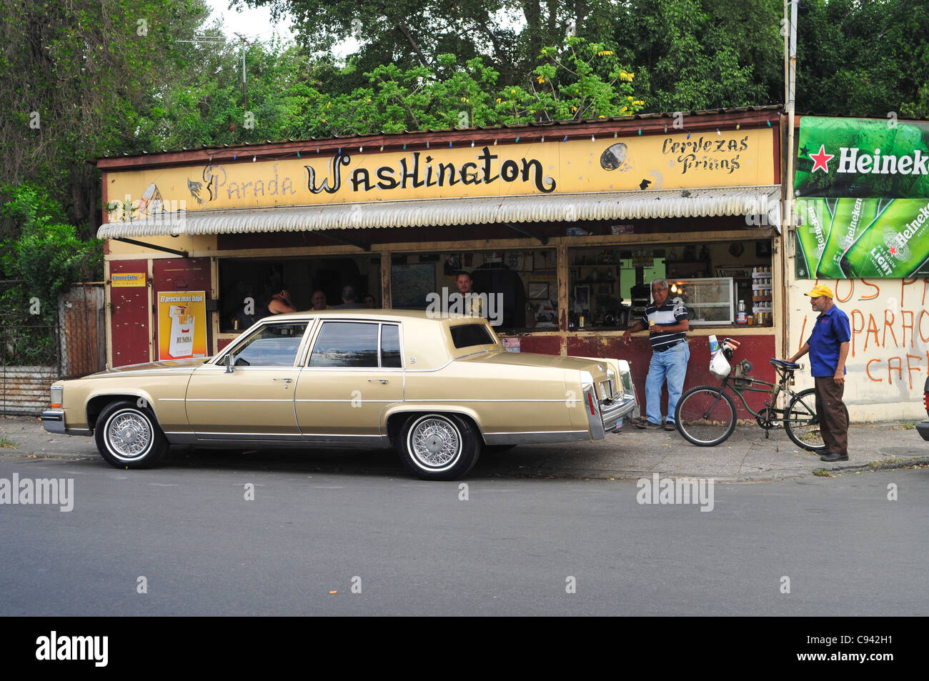 Picture shows a typical bar facing a street in the town of Ponce, Puerto Rico where people stop for a drink along Stock Photo