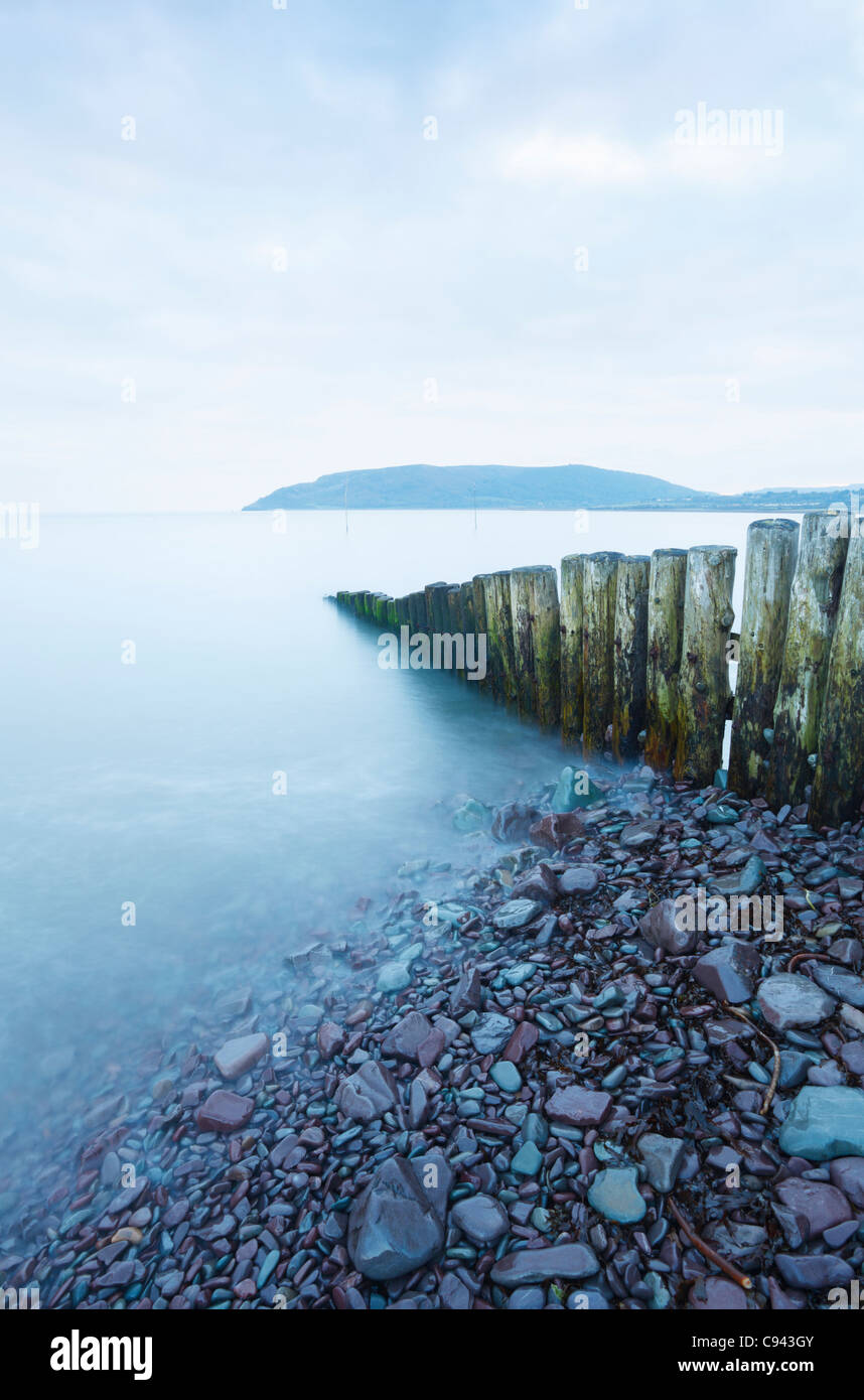 Groyne at the entrance to Porlock Weir Harbour with Bossington Hill in the Distance. Somerset. England. UK. - Stock Image