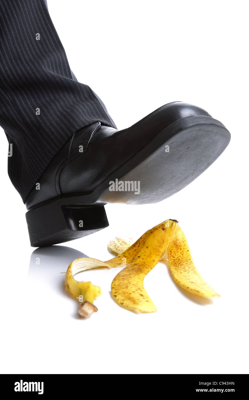 Falling on a banana skin - Stock Image
