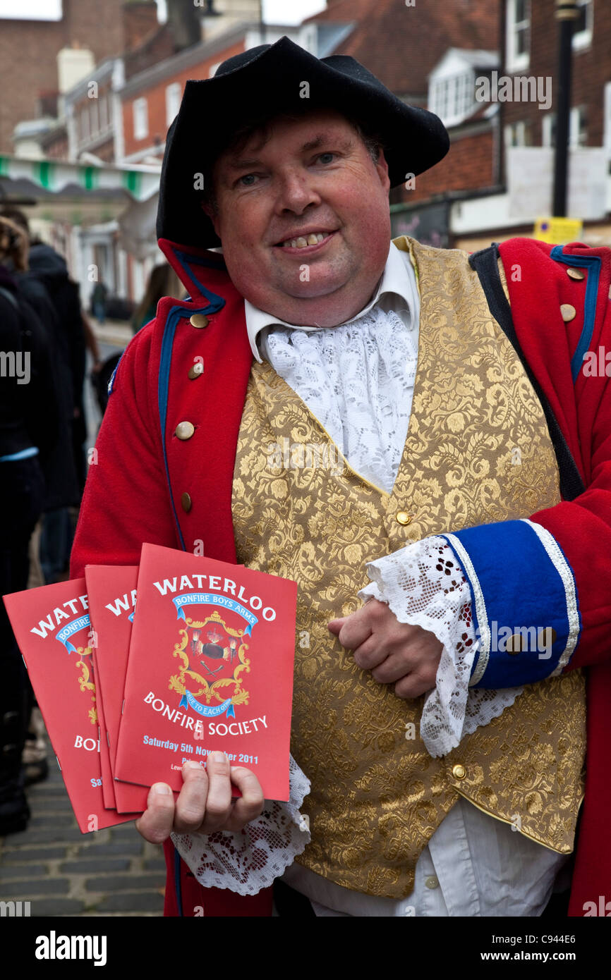 Man selling bonfire society programmes on Guy Fawkes night, Lewes, Sussex, England - Stock Image