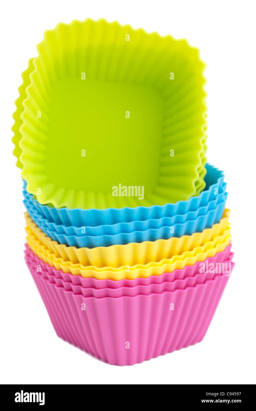 Pile of mixed colours silicone cupcake mould cases - Stock Image