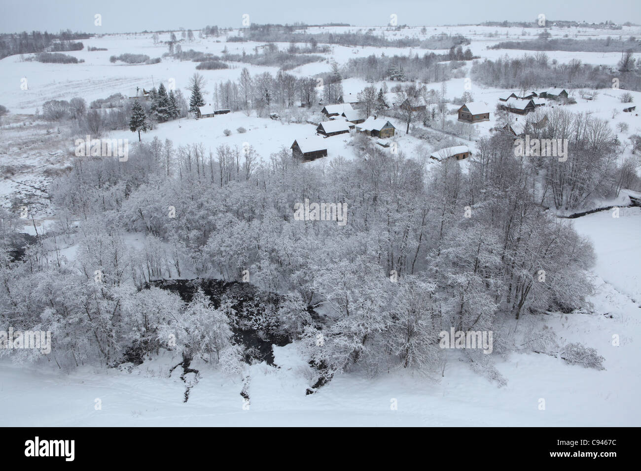Russian winter. Snow covered outskirts of the Izborsk Fortress with the village of Kruppsk in Pskov region, Russia. - Stock Image