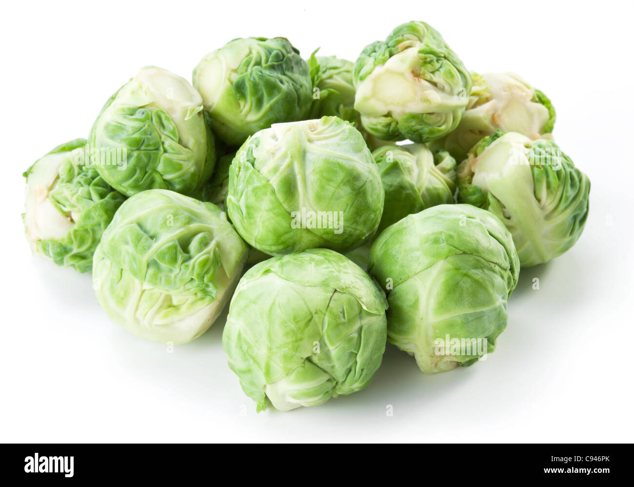 Lot of brussels sprouts isolated on a white background. - Stock Image
