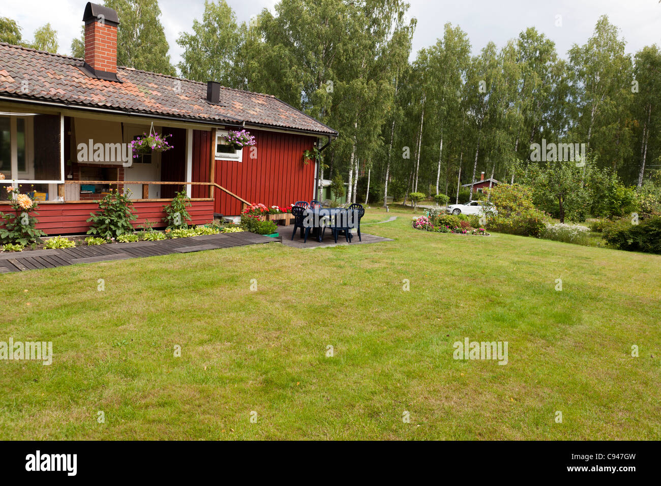 Red summer cottage in Sweden, property release available - Stock Image