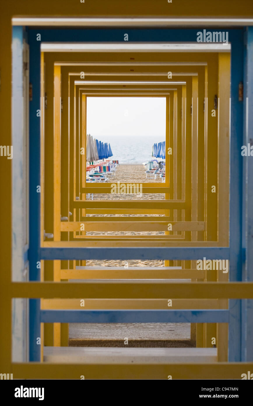 View of a sea through a row of changing booths - Stock Image