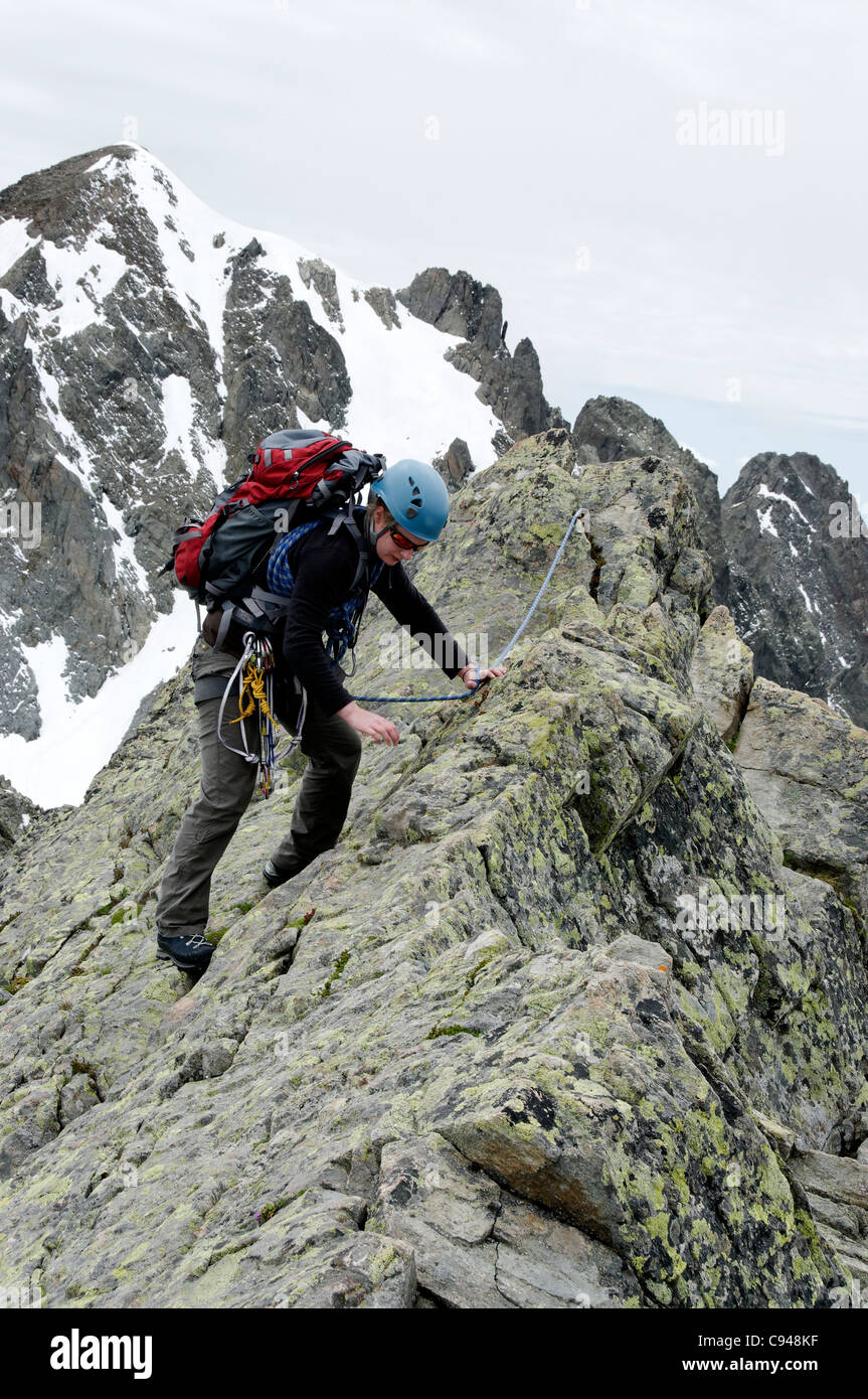An alpiniste on the Chamonix classic Traverse of the Crochues. - Stock Image