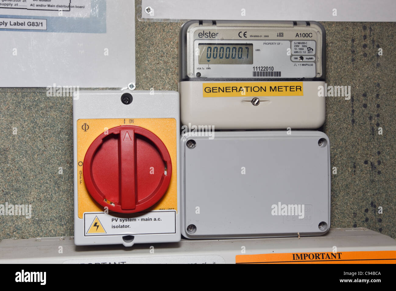PV isolation switch and new domestic Generation meter recording number of units of electricity generated by solar - Stock Image