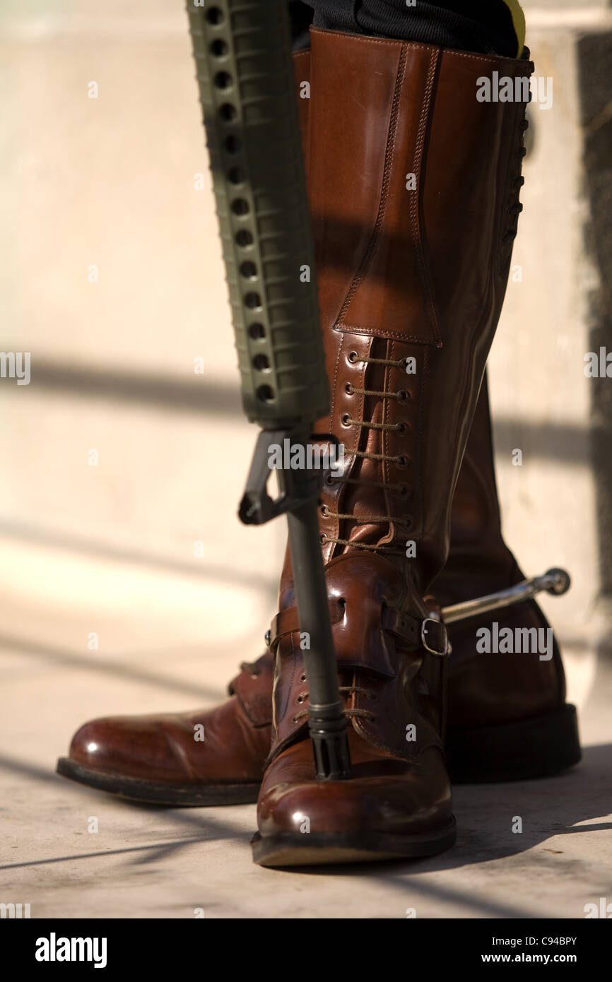 London Ontario, Canada - November 11, 2011. The boots and rifle of a RCMP  officer standing a post during Remembrance Day ceremonies at the Cenotaph  in ...