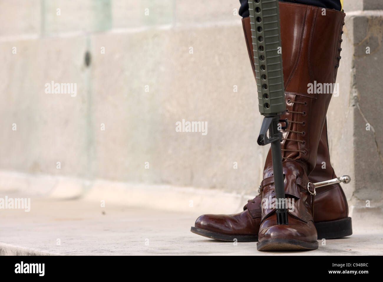 London Ontario, Canada - November 11, 2011. The boots and an automatic  rifle of a RCMP officer standing a post during Remembrance Day ceremonies  at the ...