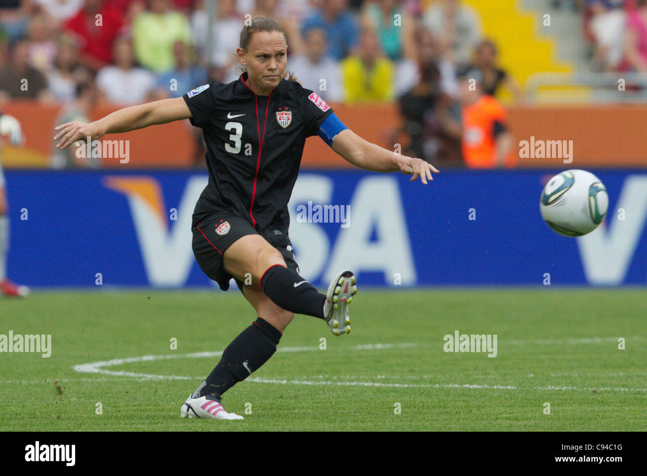United States team captain Christie Rampone kicks the ball during a Women's World Cup quarterfinal soccer match - Stock Image