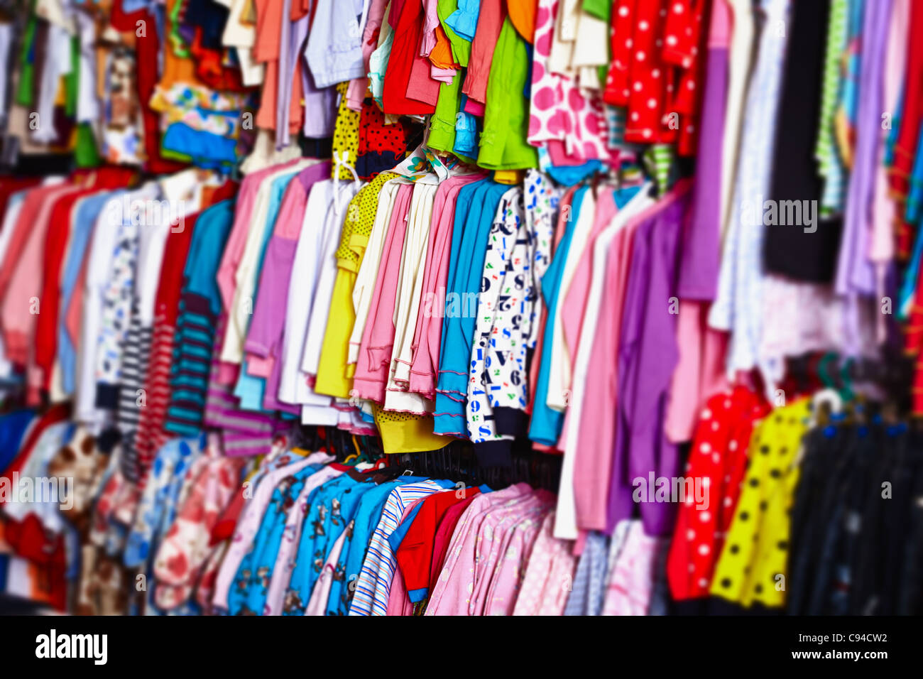 Colorful Baby Clothes Hanging On Hangers In A Store Stock Photo