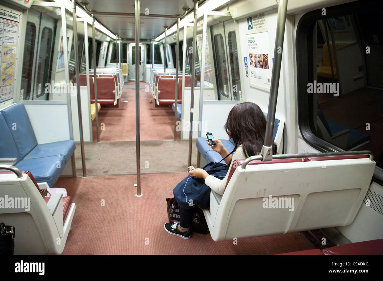 Single woman on an otherwise empty metro subway train, Washington DC USA Stock Photo