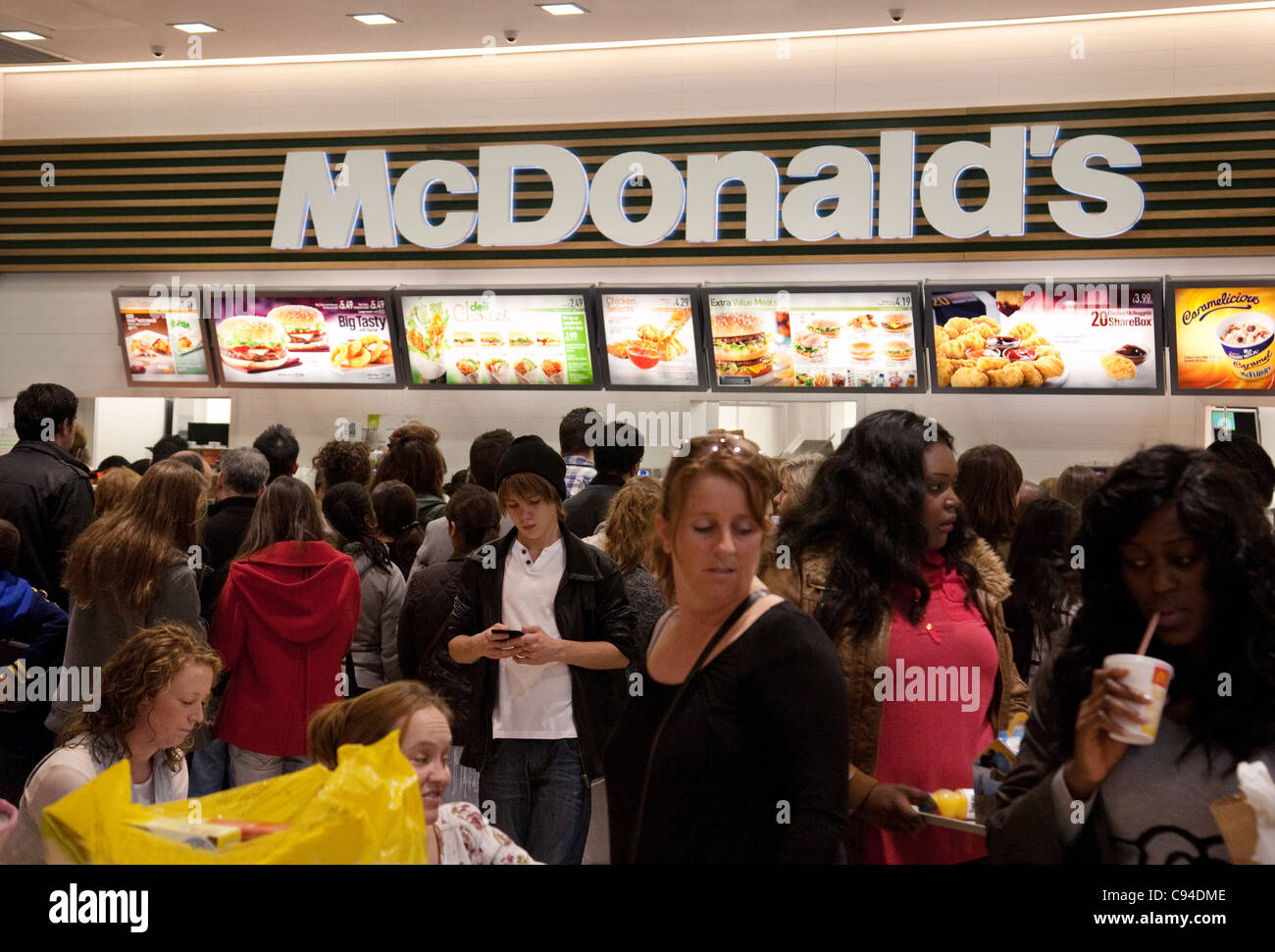 People eating at McDonalds, westfield shopping centre UK - Stock Image