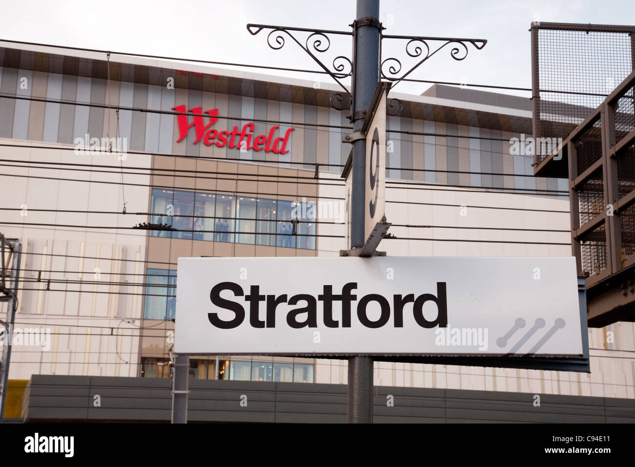Stratford station sign east London, with Westfield shopping centre sign in the background, London UK Stock Photo