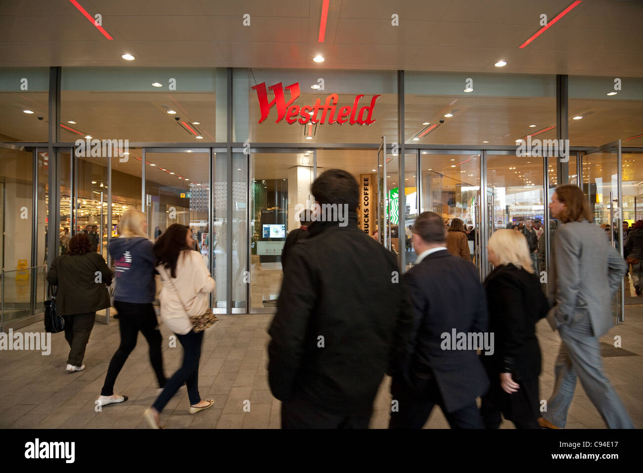 Shoppers at entrance to Westfield shopping centre, Stratford, London UK - Stock Image