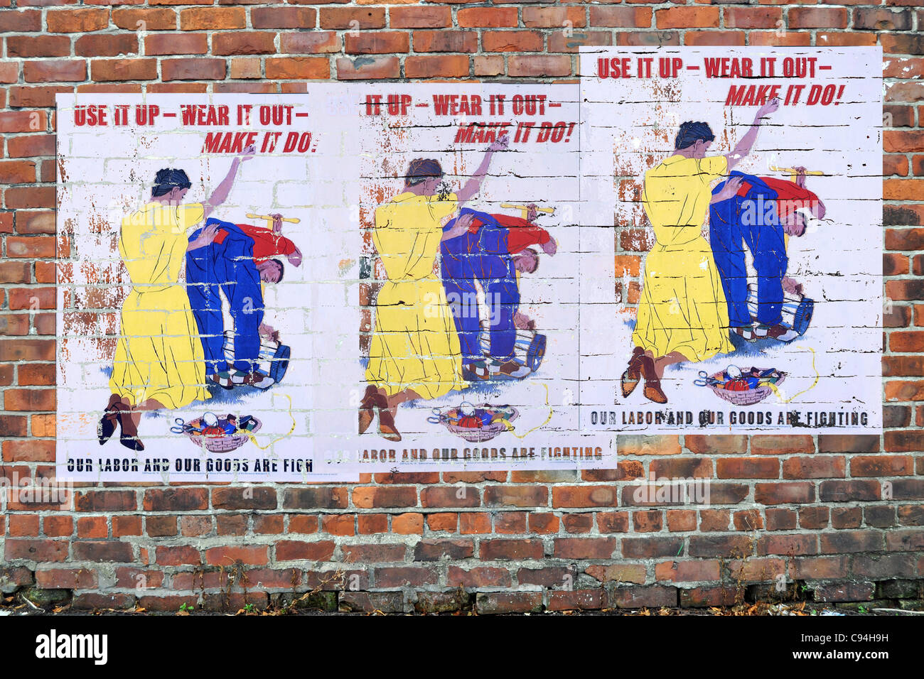 American WW2 Propaganda Posters on a brick wall - Stock Image