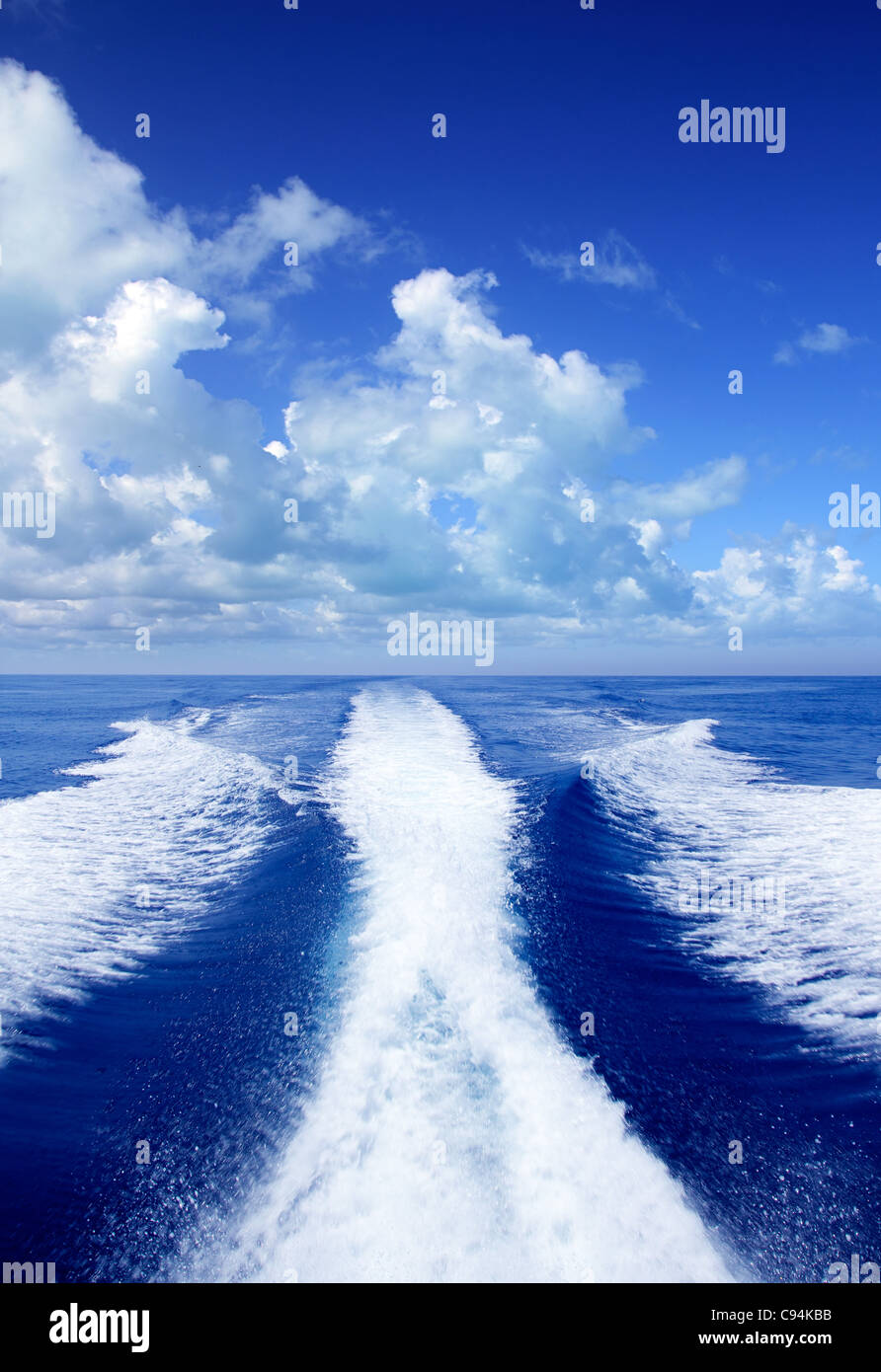 Boat wake prop wash on blue ocean sea in sunny day - Stock Image