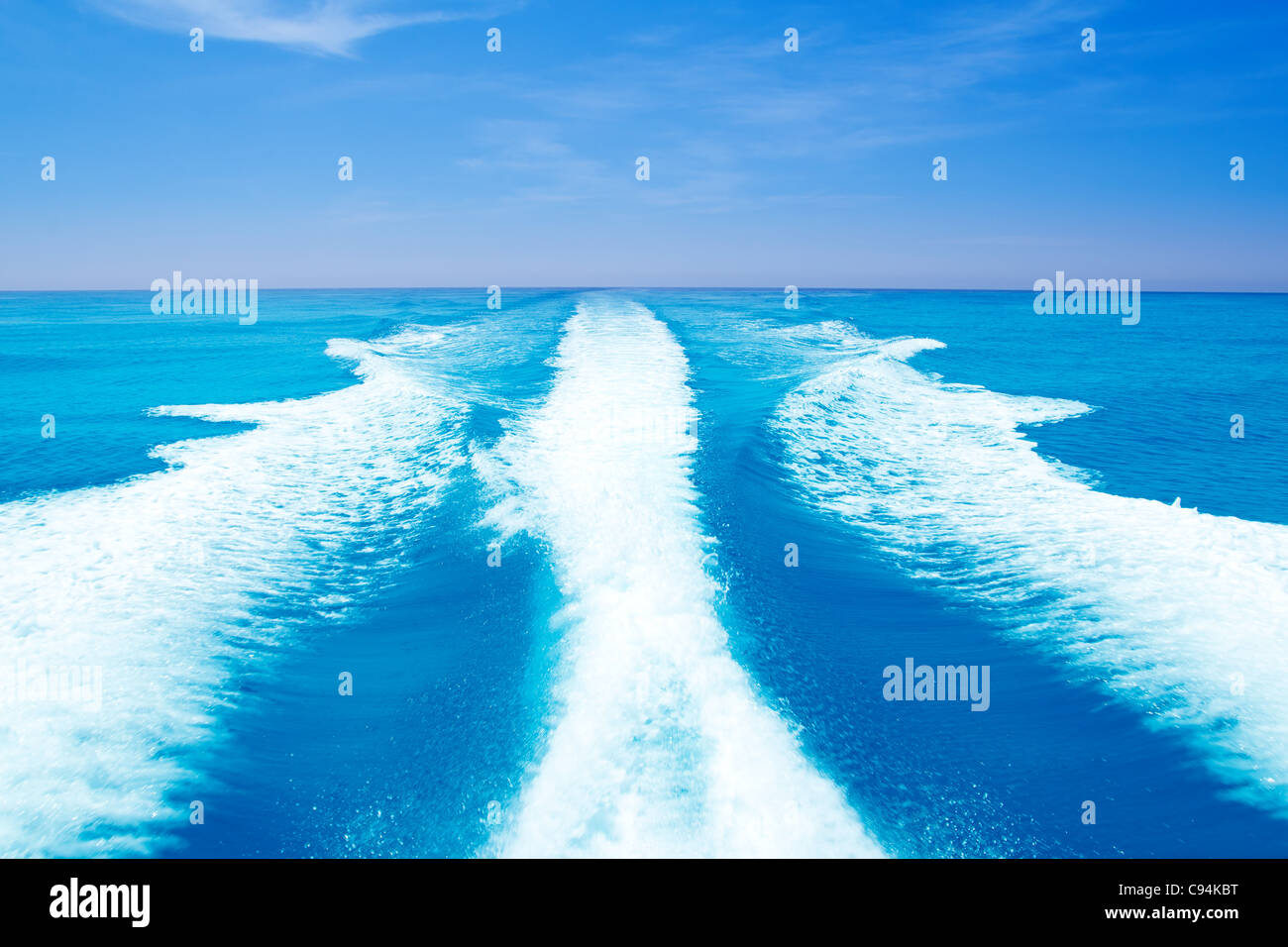 Boat wake prop wash on turquoise sea in sunny day Stock Photo