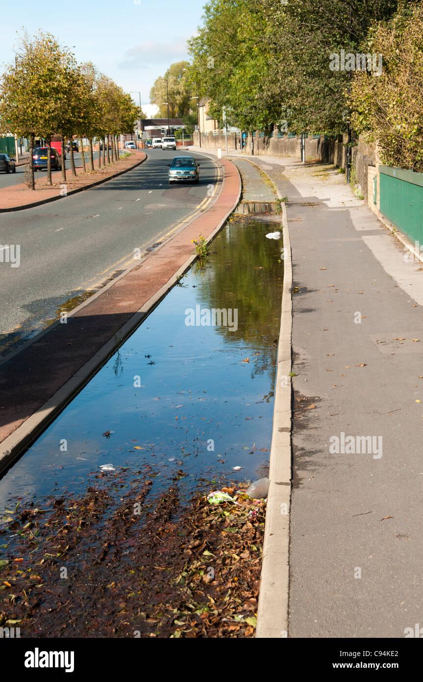 Flooded cycle lane, Alan Turing Way, Clayton, Manchester, England, UK - Stock Image