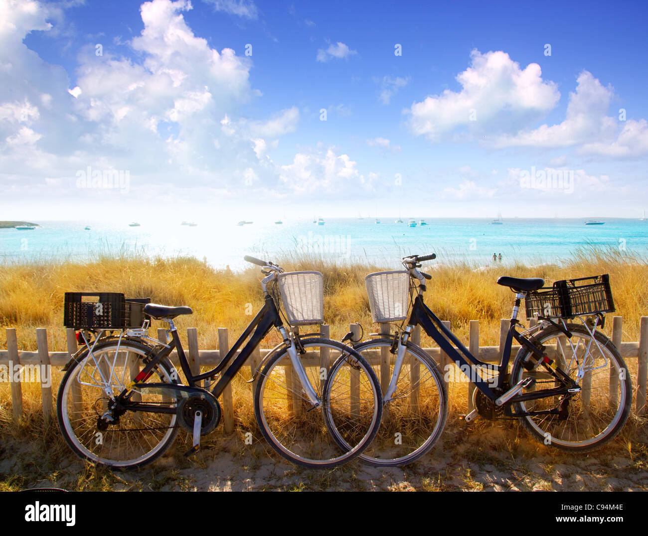bicycles couple parked in Formentera beach of Illetes - Stock Image