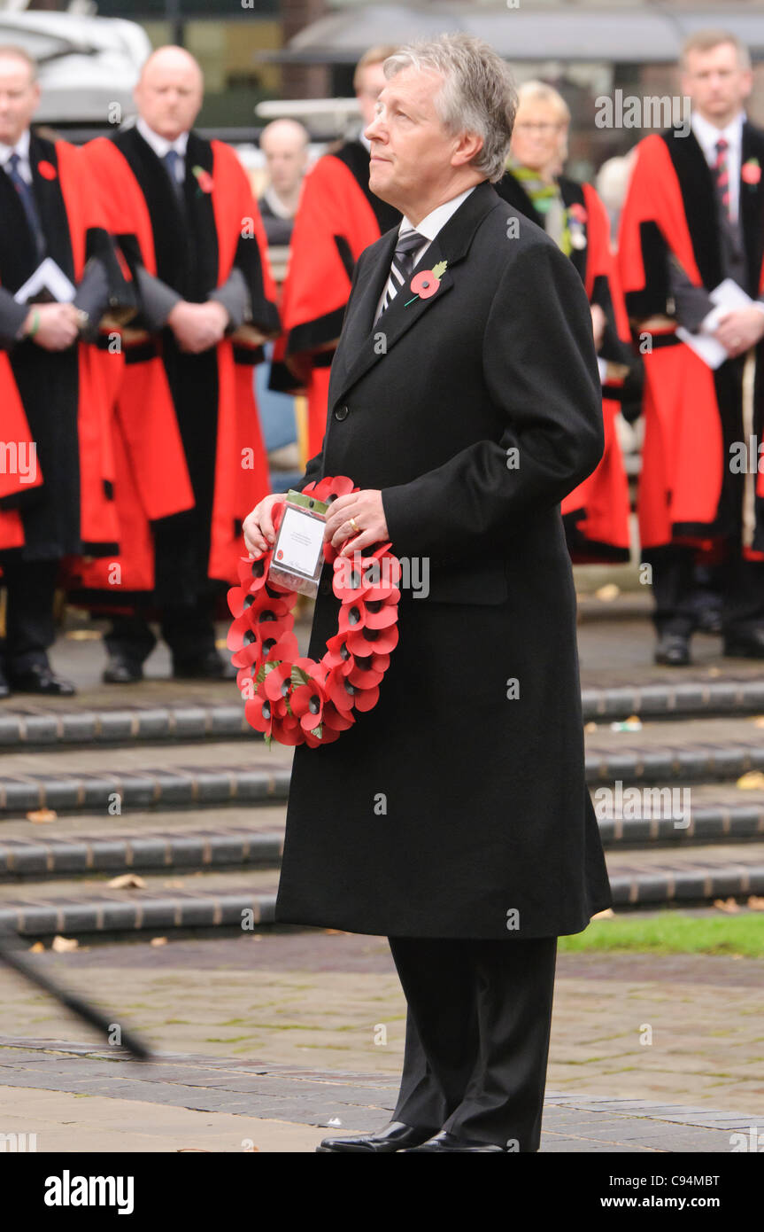 Peter Robinson, First Minister for Northern Ireland, lays a wreath during the Remembrance Sunday wreath laying ceremony, - Stock Image
