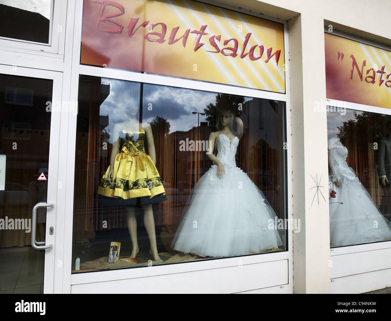 Bridal gawn in a shop window in Hamburg, Germany - Stock Image
