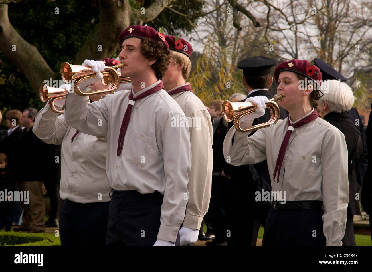 Scouts and Guides play the Last Post in Lichfield Memorial Gardens on Remembrance Sunday 2011 - Stock Image