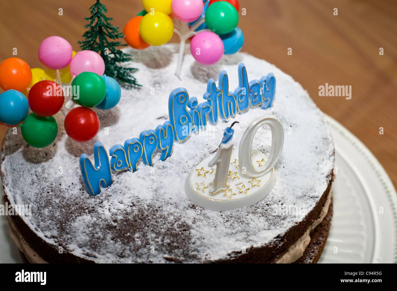 A birthday cake celebrating someone's tenth birthday - Stock Image