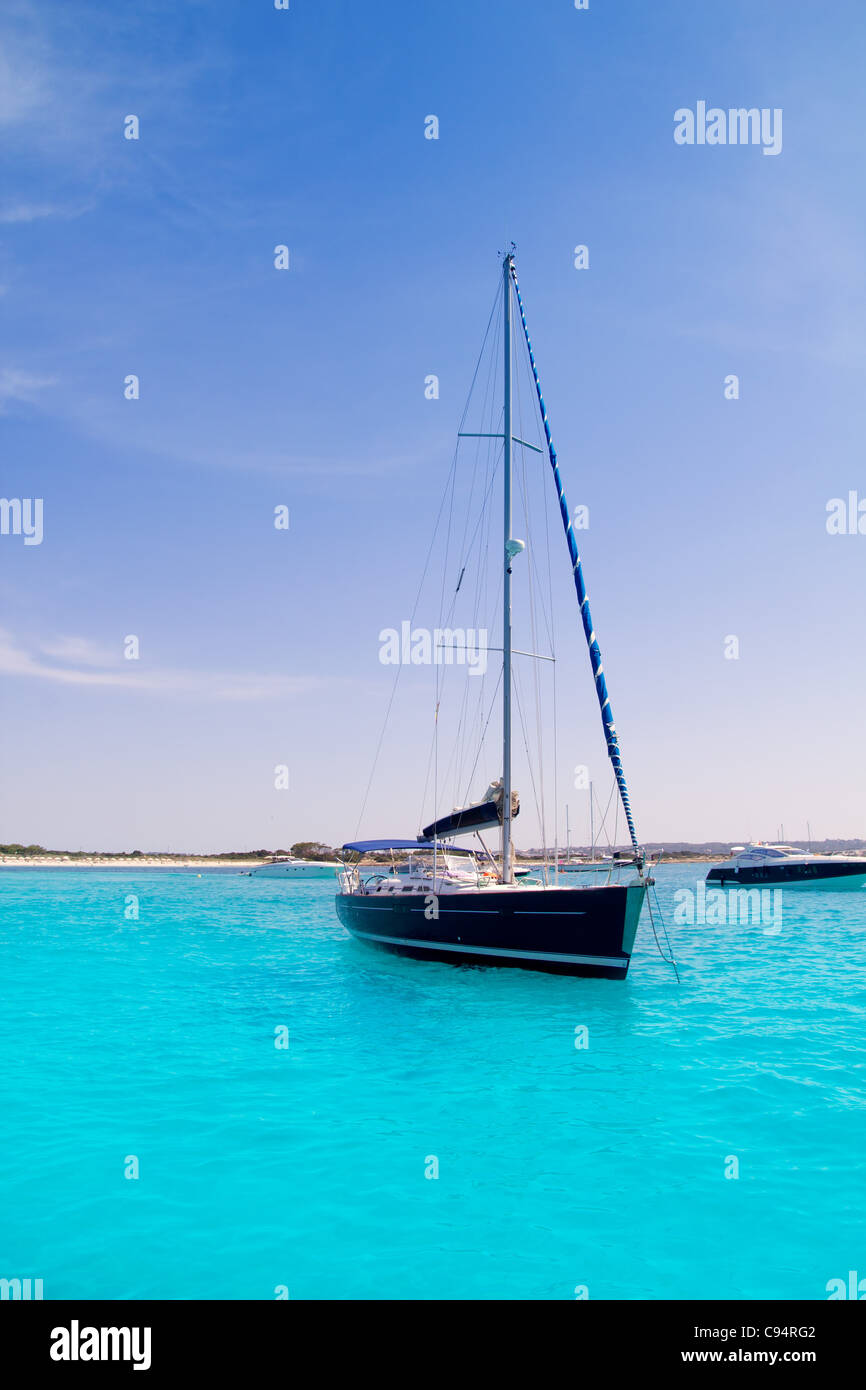 Luxury sailboat in turquoise beach of Formentera Illetes - Stock Image