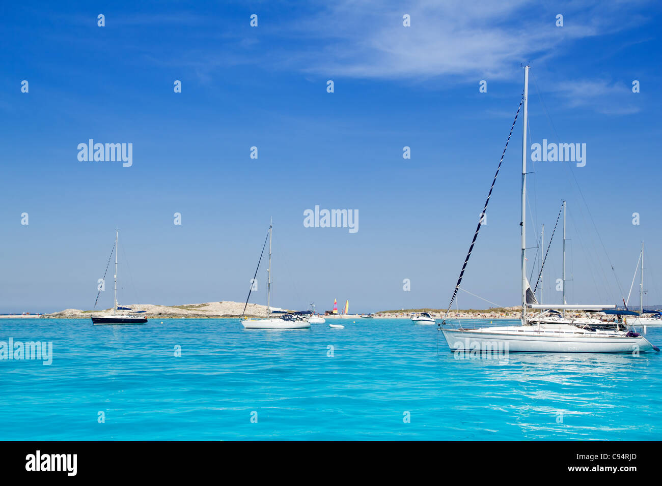 Luxury sailboats in turquoise beach of Formentera Illetes - Stock Image