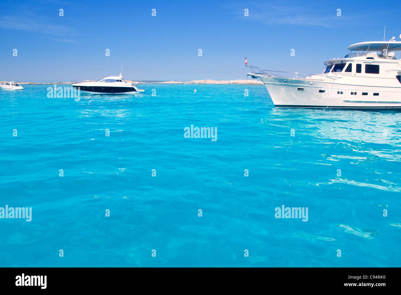 Luxury yatch in turquoise beach of Formentera Illetes - Stock Image