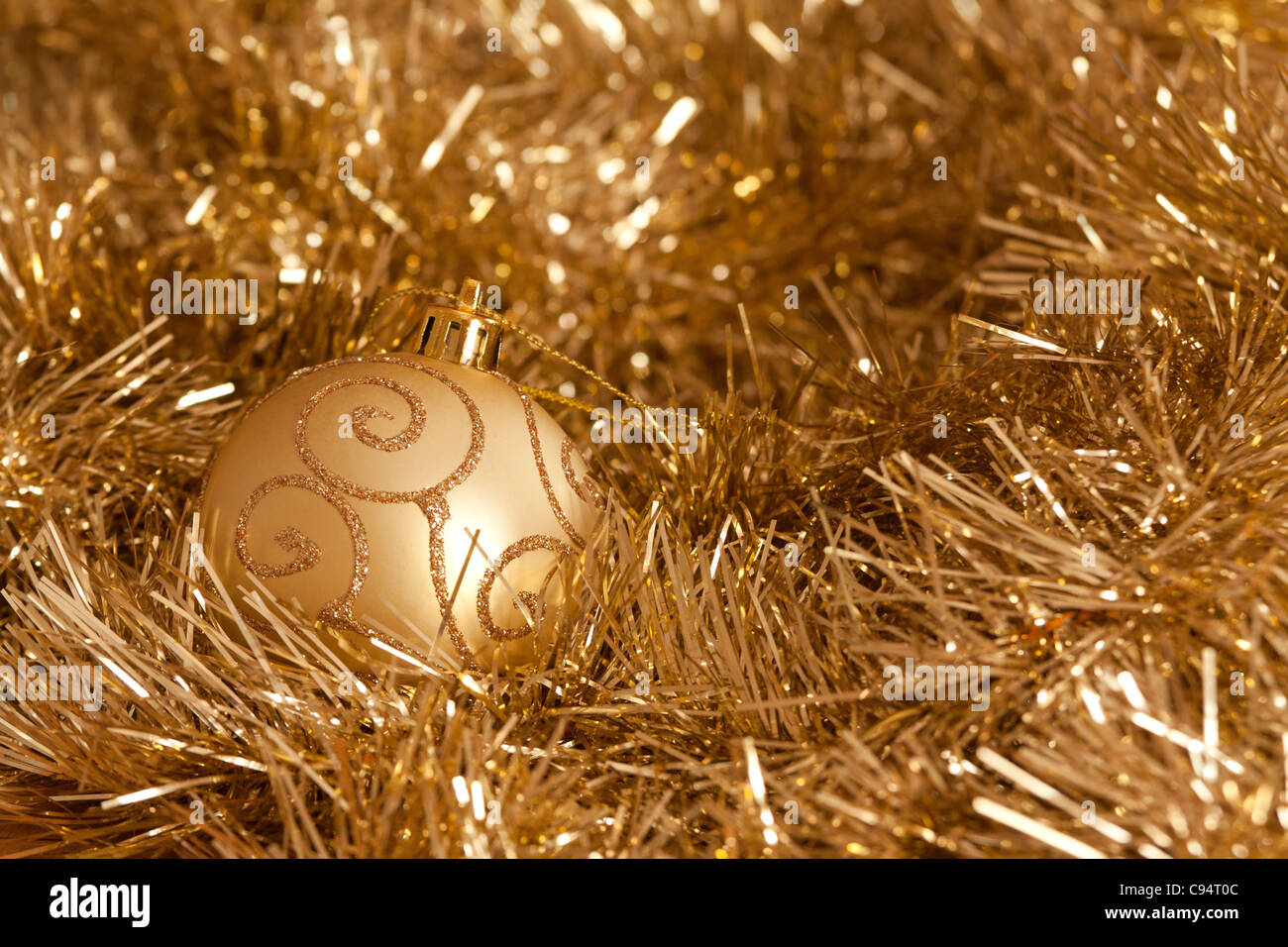 golden christmas decorations bauble and tinsel stock image
