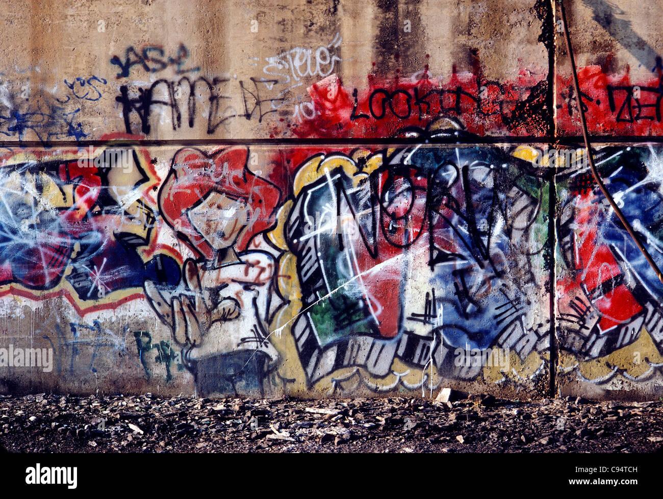 Colorful graffitti art on a concrete wall in Philadelphia, Pennsylvania, USA - Stock Image