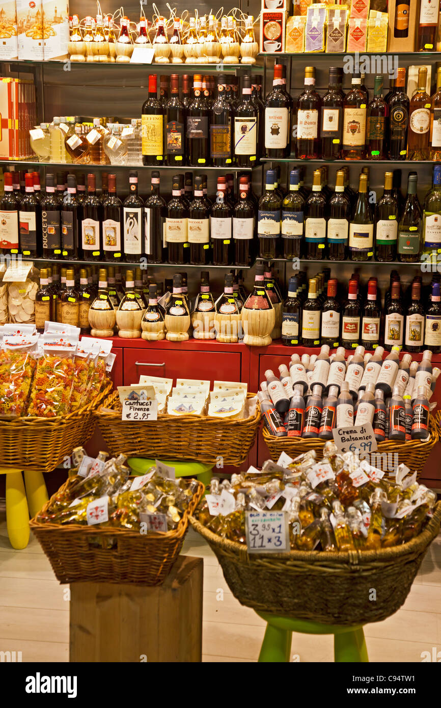 Food and wine for sale at the Mercato Centrale in Florence, Italy: coffee, wine, pasta, Cantucci, Crema di Balsamico - Stock Image