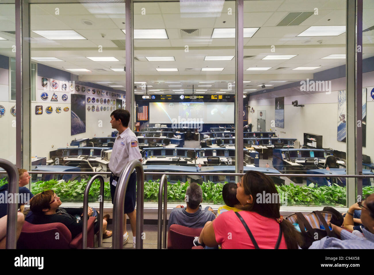 Visitors on a guided tour of the Mission Control Center at the Johnson Space Center, Houston, Texas, USA - Stock Image
