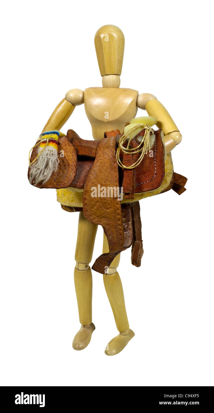 Carrying a western saddle made of heavy tan leather for riding domestic horses - path included - Stock Image