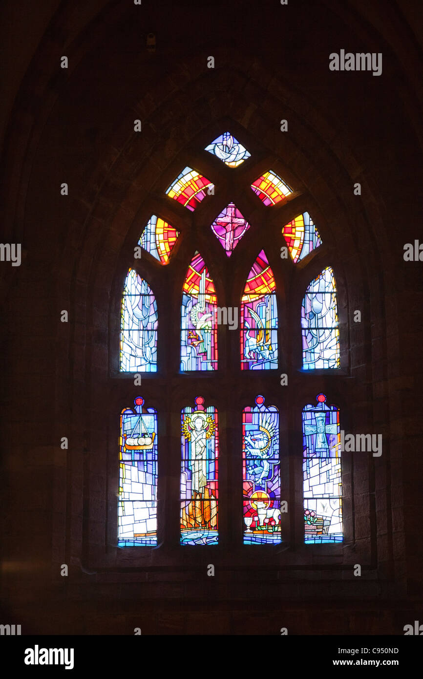Stained glass windows in St Magnus Cathedral in Kirkwall on mainland Orkney. - Stock Image