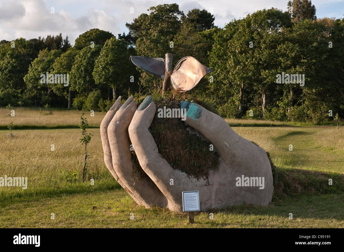 Cotehele, Cornwall, UK. Sculpture by Brendan Murless in the 'Mother Orchard' which contains rare local varieties - Stock Image