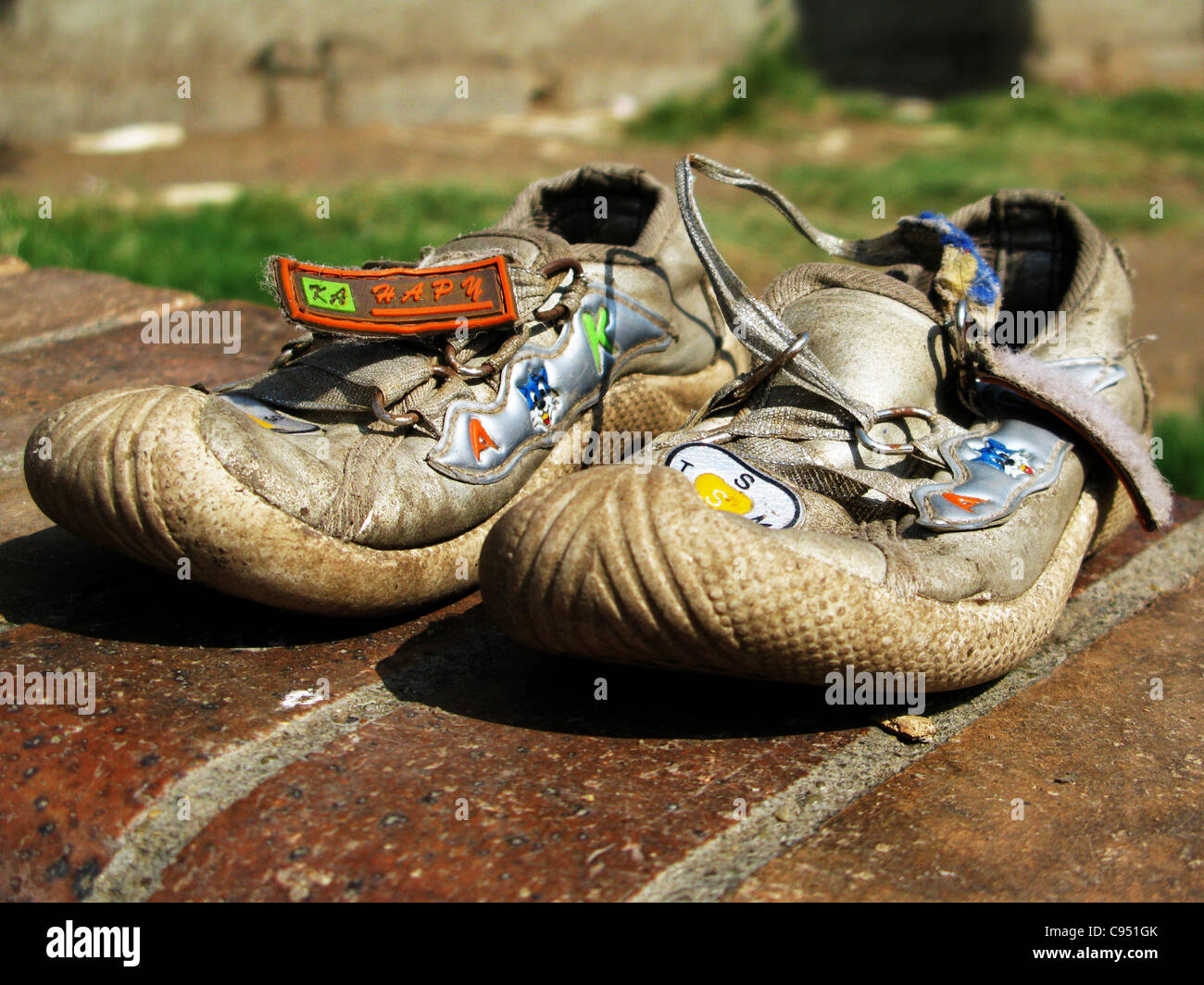 Pair of abandoned children's shoes - Stock Image