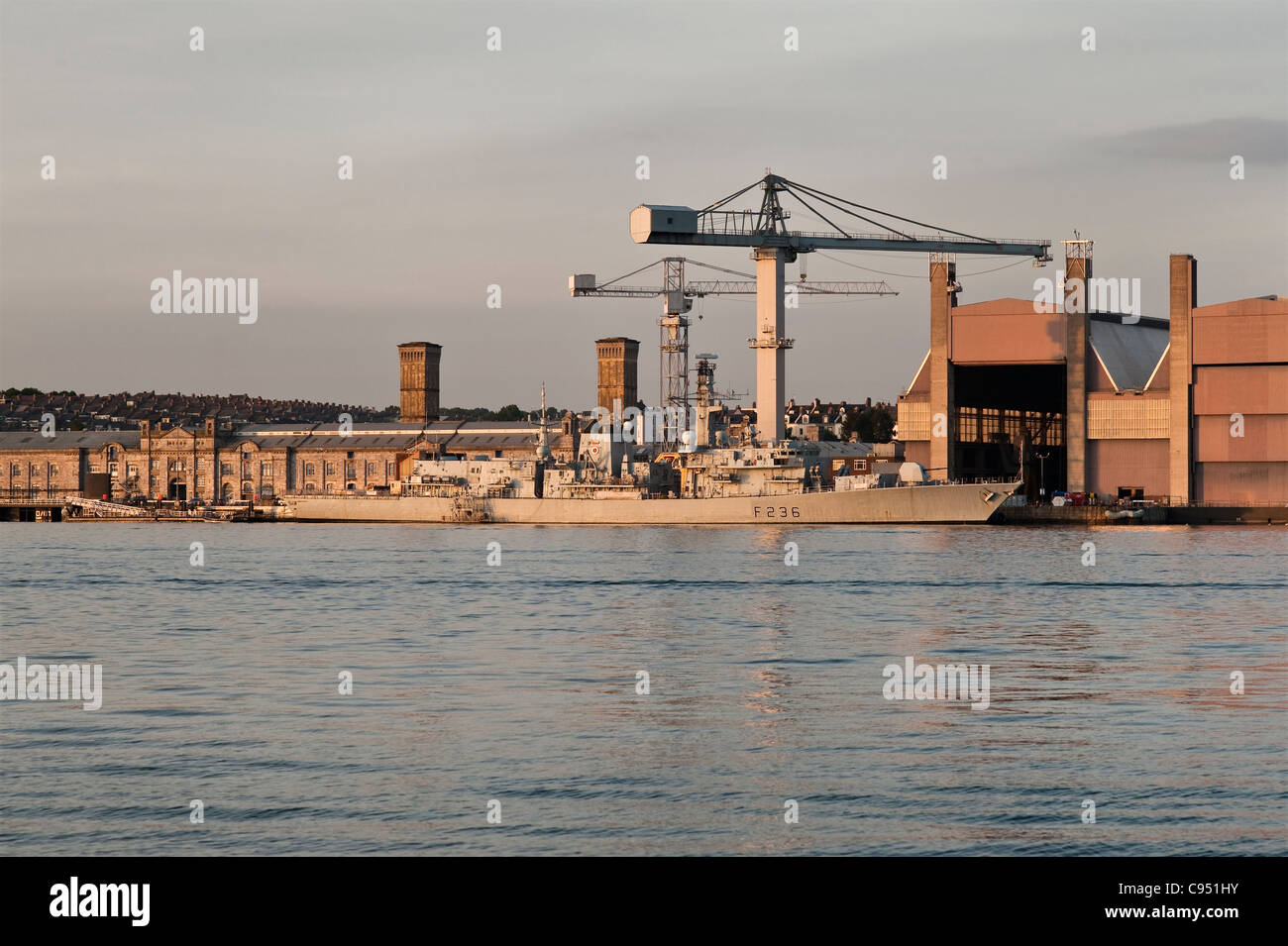 The Devonport Royal Dockyard, Plymouth, Devon, UK with HMS Montrose, a Type 23 frigate of the Royal Navy Stock Photo