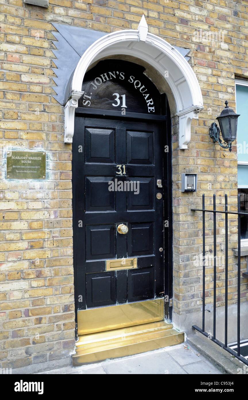 Black painted front door St John's Square, Marjory Warren House, British Geriatrics Society City of London England - Stock Image