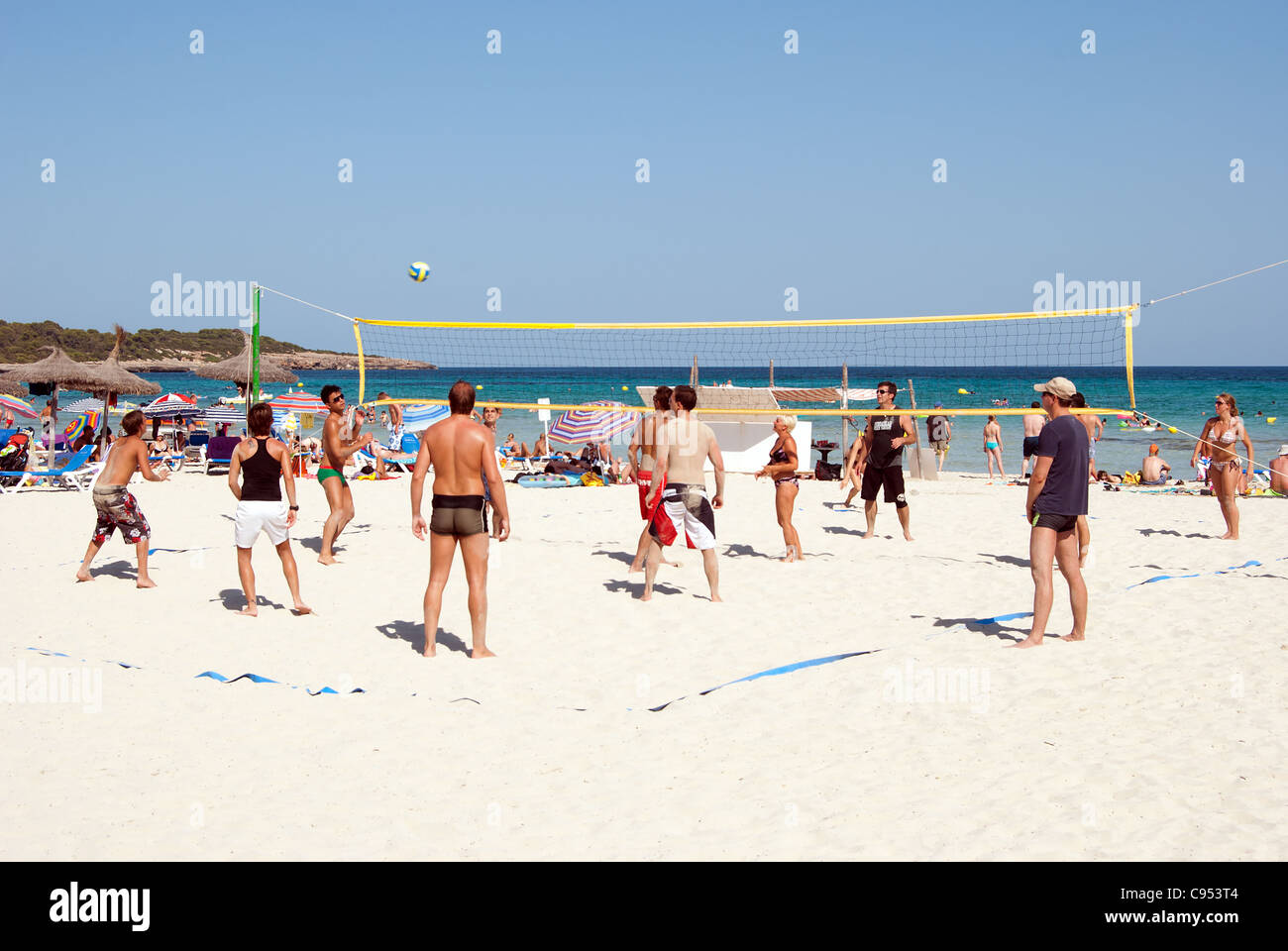 People playing beach volleyball in Sa Coma, Mallorca, Spain - Stock Image
