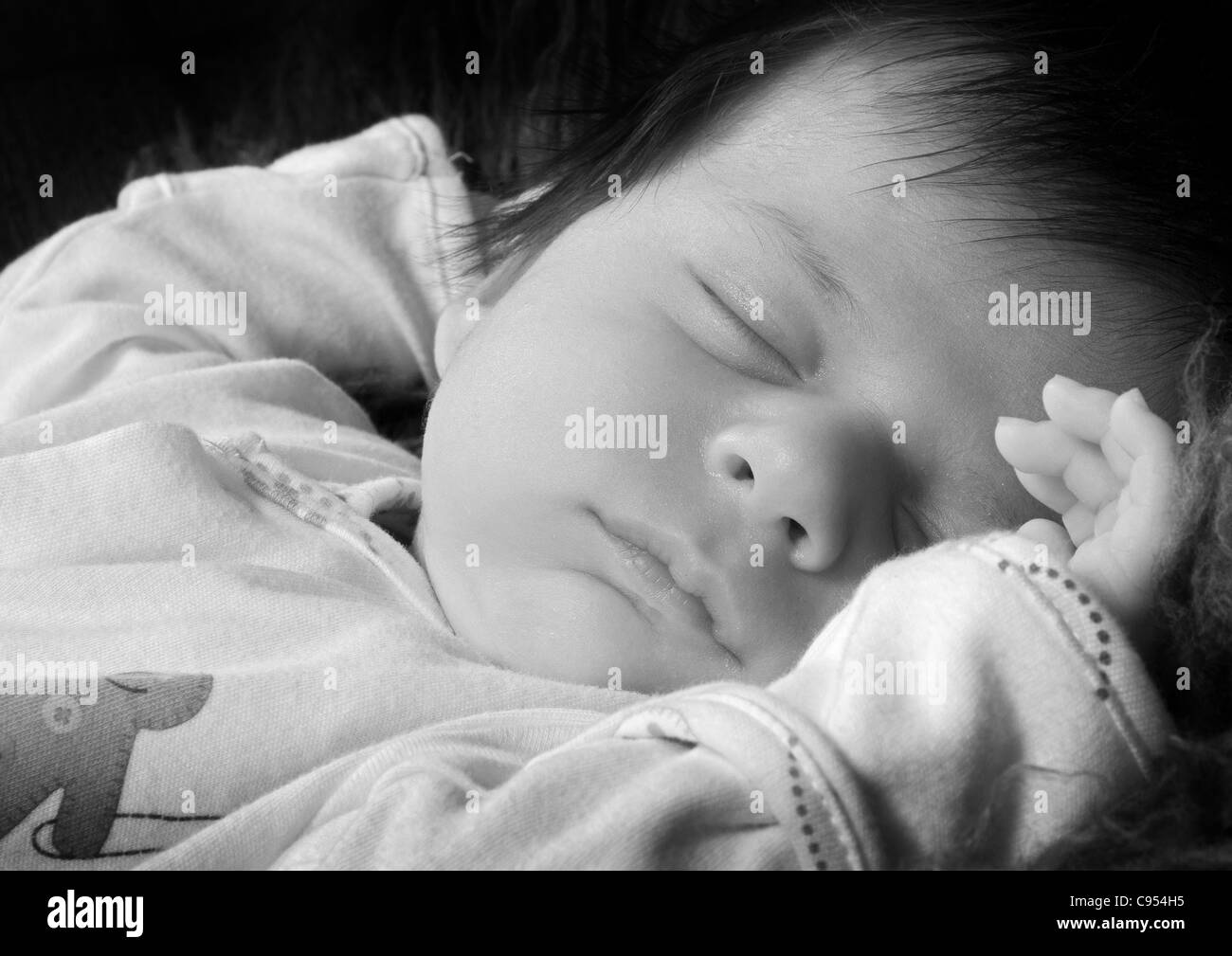 A sleeping 5 week old baby. - Stock Image