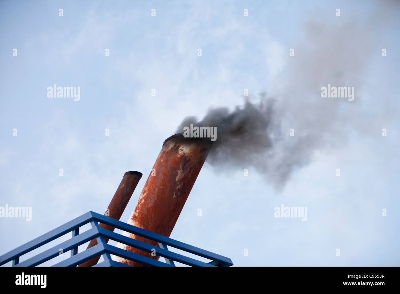 Exhaust emissions, burning marine diesel in a ships engine. Marine diesel is one of the most polluting fuels in - Stock Image