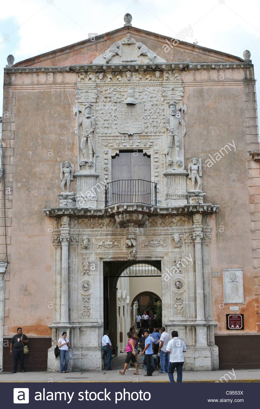 People walking in front of the Casa de Montejo in Merida, Mexico. Stock Photo
