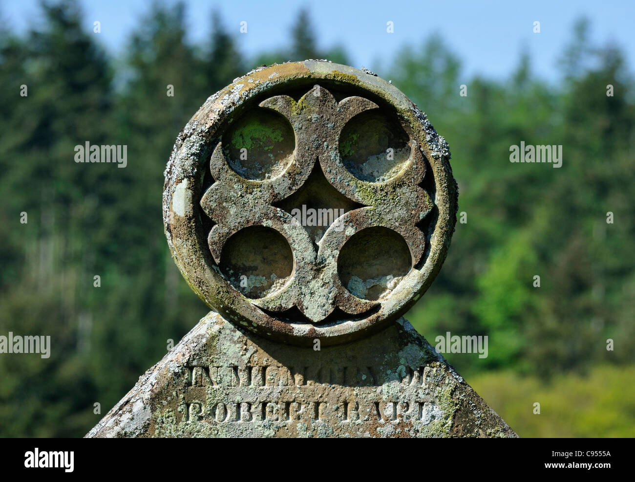 Detail of gravestone with cross motif. Church of Saint Michael, Lowther, Cumbria, England, United Kingdom, Europe. Stock Photo