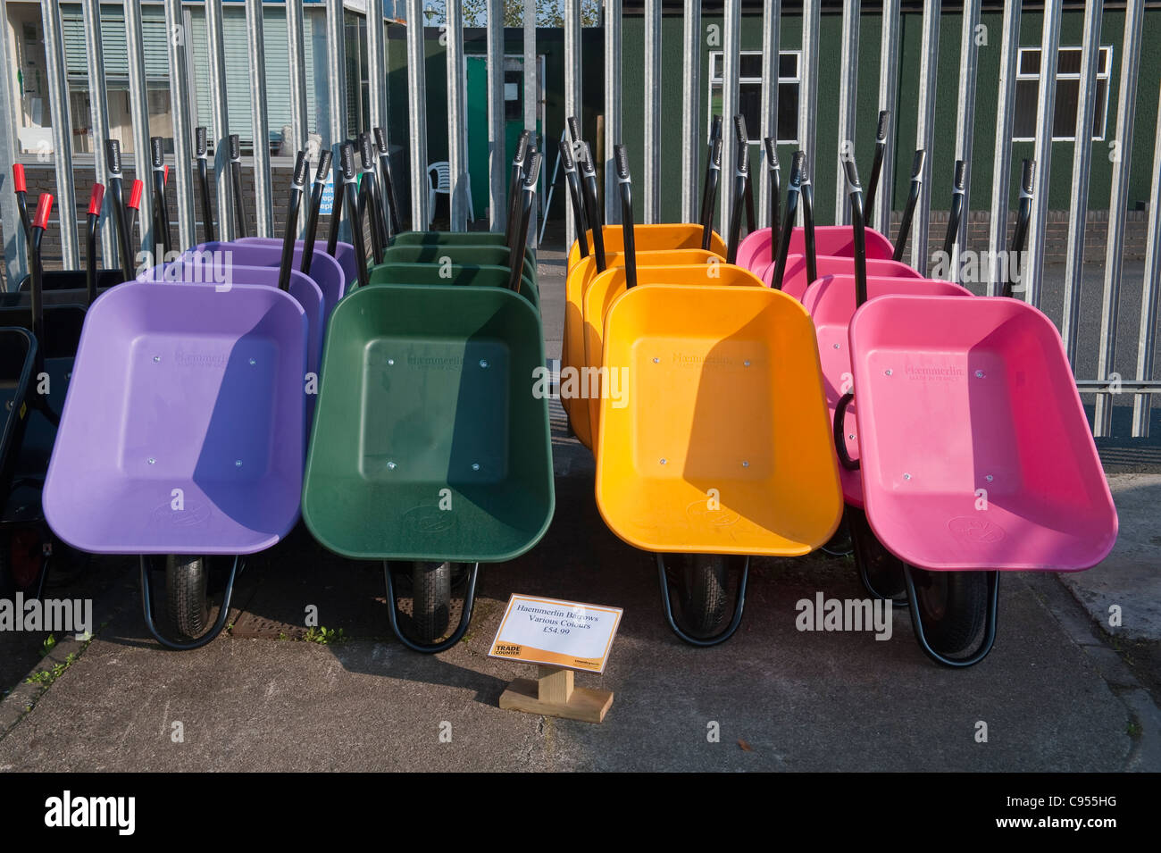 Countrywide Stores, Presteigne. Plastic wheelbarrows - Stock Image
