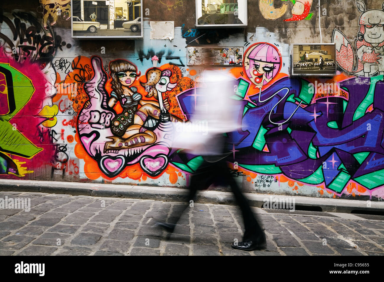 Colourful street art decorates the walls of Hosier Lane in central Melbourne, Victoria, Australia - Stock Image