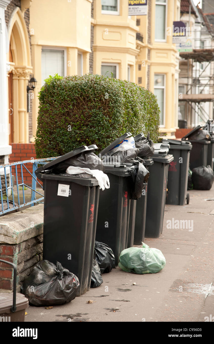 Rubbish bins outside student houses, Colum Road, Cardiff, Wales UK - Stock Image